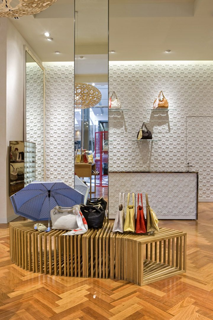 Oroton store by Red Design Group, Doncaster Melbourne store design  i love the design of the products displays and placement of products