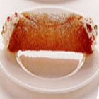 Cannoli Filled with Pistachio Ricotta - Tube-shaped shells of fried pastry dough, filled with a sweet creamy filling, cannoli originated in Sicily and are an essential part of Sicilian cuisine, as well as being very popular in Italian American cuisine.