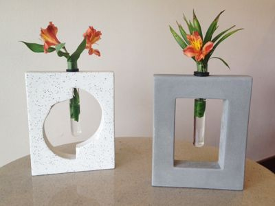 Concrete bases with test tube vase inserts. CUTE! We make these in house and we can ship them! Customize with your own design. (303) 903-4485