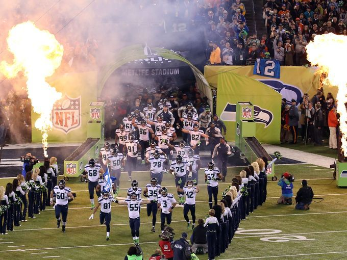 The Seattle Seahawks run onto the field for Super Bowl XLVIII against the Denver Broncos at MetLife Stadium
