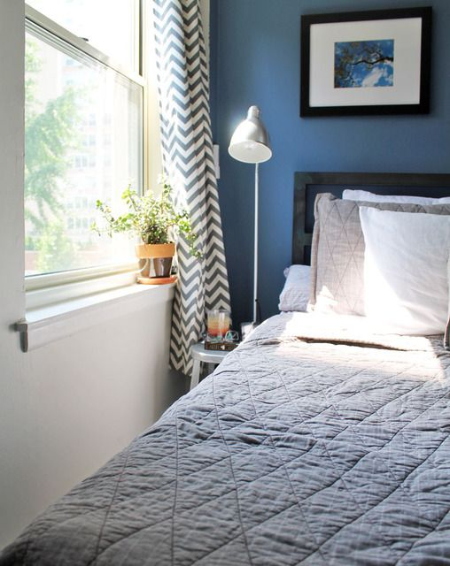 Tiny bedroom inspiration from Apartment Therapy! Love the tiny stool as a bedside table.