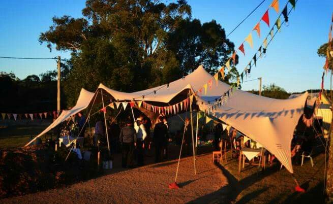 This sand stretch tent looking very festive with flags and pops of colour! #stretchtent #marquee #wedding #outdoorwedding #eventhire #eventstyling #marqueehire #stretched_events #unique #decor #decoration #bohemian #boho #rustic #festivalwedding #outdoorwedding #nature #melbournebride #sydneybride #bride #bridal #diy #recycle #creative #earthy