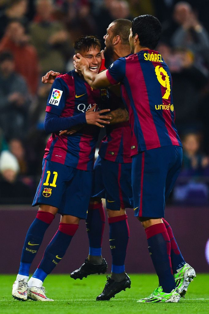 Neymar of FC Barcelona celebrates with his teammates Dani Alves (C) and Luis Suarez of FC Barcelona after scoring his team's fifth goal during the Copa del Rey Round of 16 First Leg match between FC Barcelona and Elche CF at Camp Nou on January 8, 2015 in Barcelona, Catalonia.