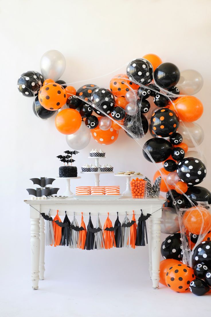 The spookiest Halloween bash filled with classic orange and black colors from Happy Wish Company