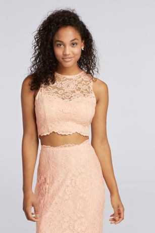 You will be a blushing beauty on your Prom night in this two piece show-stopper!  Two Piece Prom dresses areon trend and the scalloped trim adds an extra pop!  Illusion Lace neckline adds to the playful look of this dress.  Designed by Xscape.  Fully lined. Zipper Back. Imported. Spot clean only.  To protect your dress, our Non Woven Garment Bag is a must have!