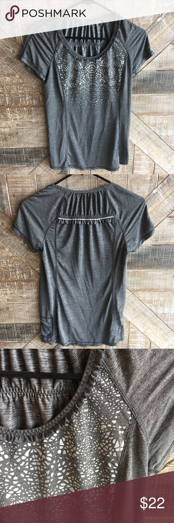 Gray Lululemon Ruffle Short Sleeve Top Gray Lululemon Short Sleeve Top with reflective Ruffle detail on the back. In good used condition, tags have been removed. Womens size 4 (located in side pocket). No trades, reasonable offers considered through the offer button. lululemon athletica Tops Tees - Short Sleeve