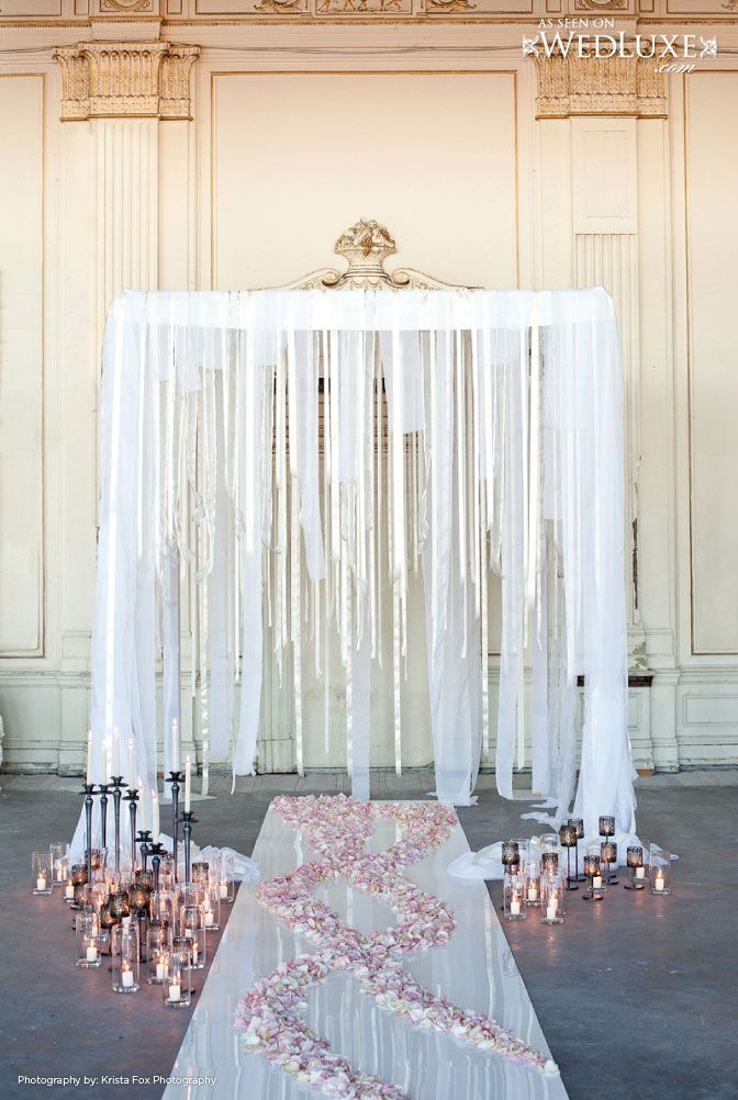 WedLuxe: House of Edward - Inspired by Cinema -- So much better than that rental arch, again, a gilt bed crown, feathers of luminous iridescent organza, the trail of rose petals, the decadence of candles strewn on the floor, as if to burn the place down would be nothing -- HMMM.