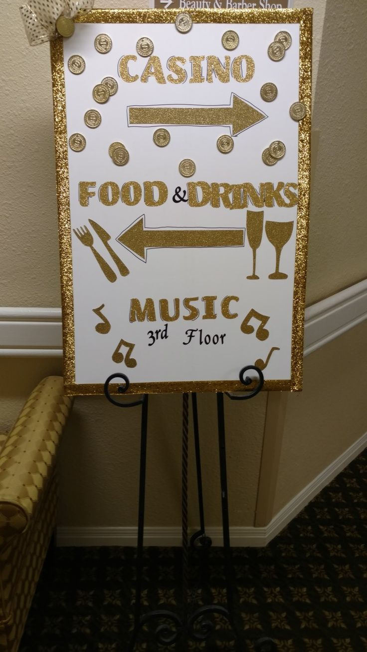 I made this sign for our Casino party to direct guests. I used a foam board, ribbon for the trim, gold stickers for the lettering, then I hand cut the arrows and food/drink symbols out of gold card stock.   #gold #casino #gamble #strikeitrich #diy #details #vegas #sign #party #decor #centerpiece #design #celebrate #classy #adult #tabledesign #amberkilgore