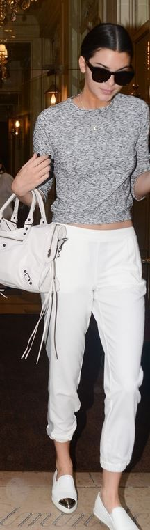 Kendall Jenner, gray sweater, silver cap toe sneakers