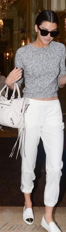 Kendall Jenner, gray sweater, silver cap toe sneakers