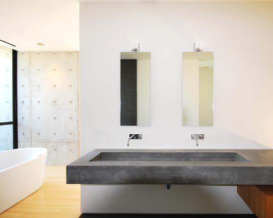 Pia dupla no banheiro feita em concreto