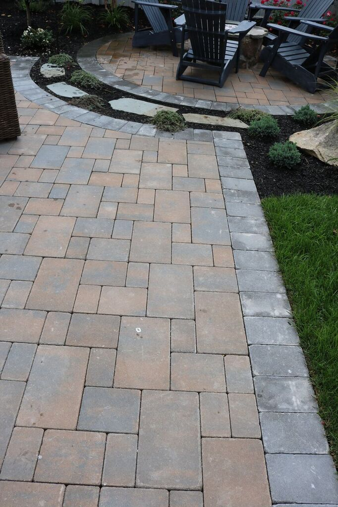 Customize your patio with Cambridge Pavingstones with ArmorTec. Check out the colors and styles offered on our website! Contractor: Design and Build Landscaping
