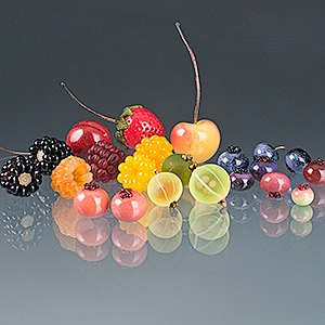 Glass fruit by Elizabeth Johnson. I actually do own a pair of berry earrings that she made... doesn't her fruit look good enough to eat!