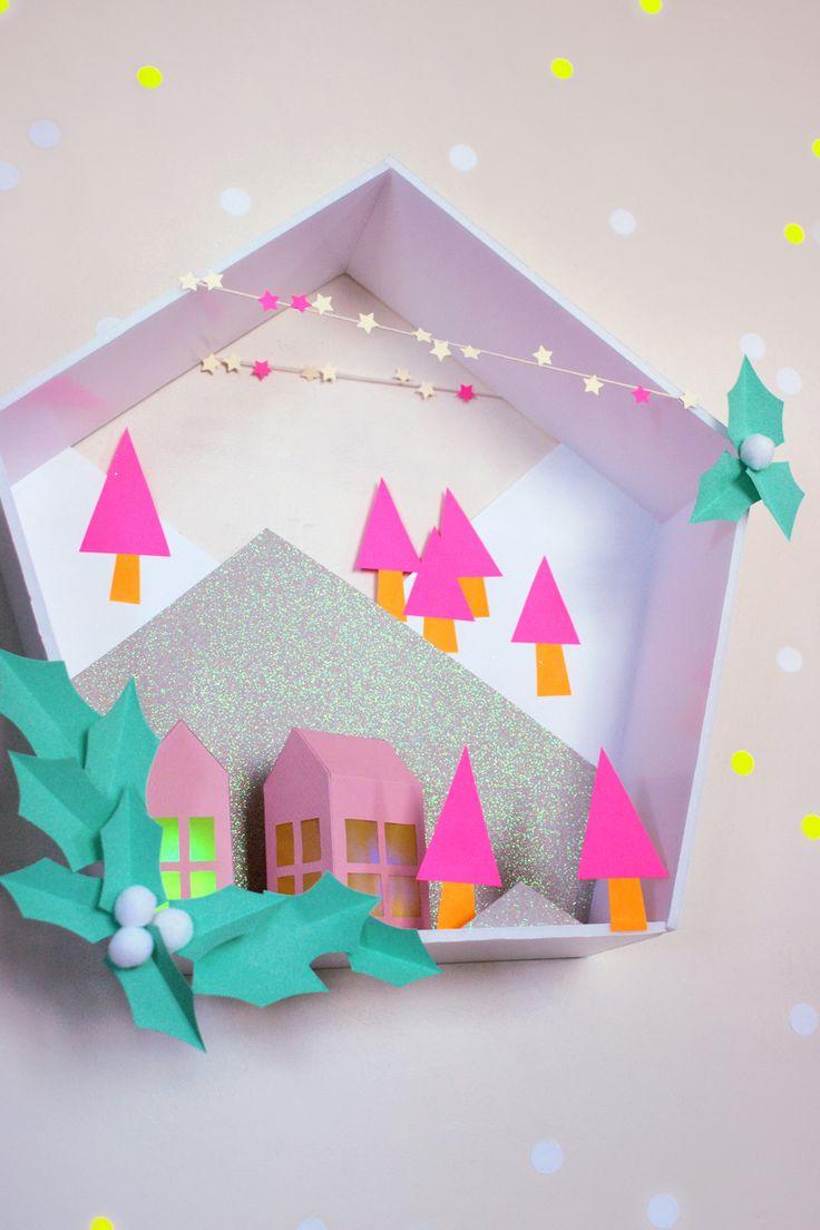 Un DIY haut en couleurs ! Il vous suffira d'un peu de carton plume et de jolis papiers acidulés pour réaliser ce paysage de montagne pour Noël !