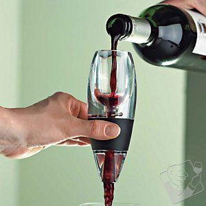Vinturi Red Wine Aerator  Love this contraption -- improves the taste of wine instantly! (There's one for white wine too.)