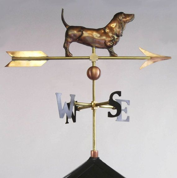 Basset Hound LPW Weathervane Hand-crafted in Meriden, Connecticut, the La Petite Basset Hound is forged in copper and brass with an emphasis on elegance, form, and functionality. The figure stands with a decorative 1.5 copper ball and measures 6″H x 9″W on a 20″ arrow. The