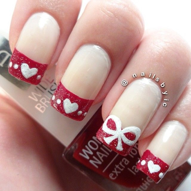 30 Best, Simple - fun red and white french Valentines Day Nail Art. http://worldinsidepictures.com/30-best-simple-charming-valentines-day-nail-art-designs/