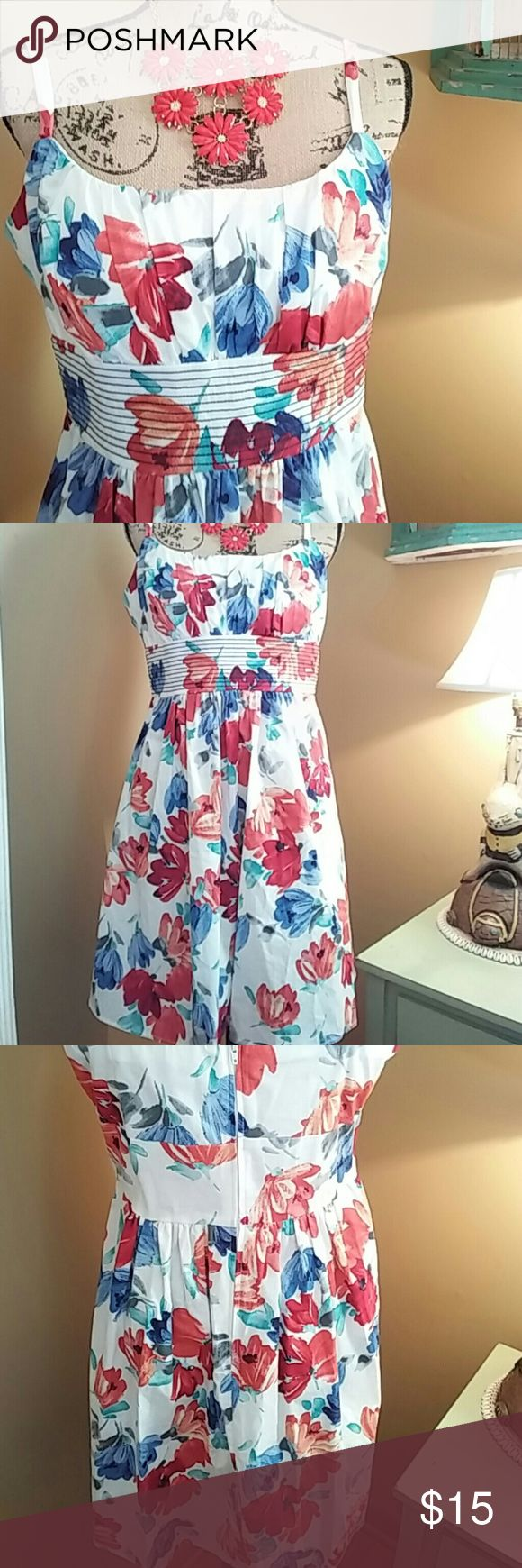 """Floral Dress Gorgeous floral dress by B. Smart. All over floral design in various shades of blues, reds and orange with pops of gray on a white backdrop. Navy stitching runs underneath bust. Adjustable straps. Semi padded cups. Back zipper with elastic around top of back. 18"""" pit to pit. 34"""" long. Waist is 19"""". Cotton/spandex. Excellent condition B. Smart Dresses Midi"""