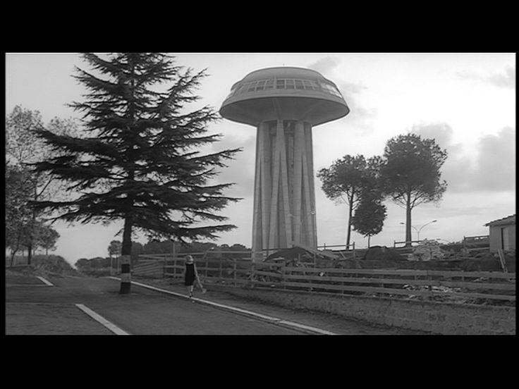 """""""L'Eclisse"""" (M. Antonioni, 1962) ~ La torre piezometrica dell'EUR, detta il """"Fungo"""", fu realizzata nel 1957.   Grazie a questa curiosa e inconfondibile struttura, l'Eur è l'unico quartiere di Roma ad avere un proprio approvvigionamento idrico, non potabile, per il mantenimento del verde pubblico."""