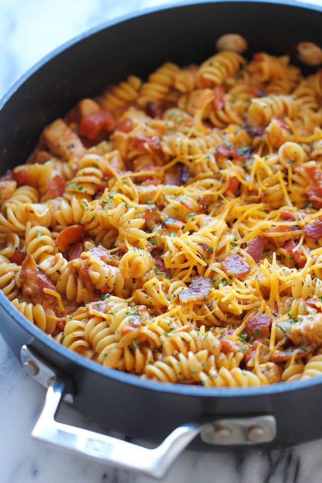 One Pot BBQ Chicken Pasta - Loaded with tangy BBQ sauce and crisp bacon. It's so easy, even the pasta gets cooked right in the pot!
