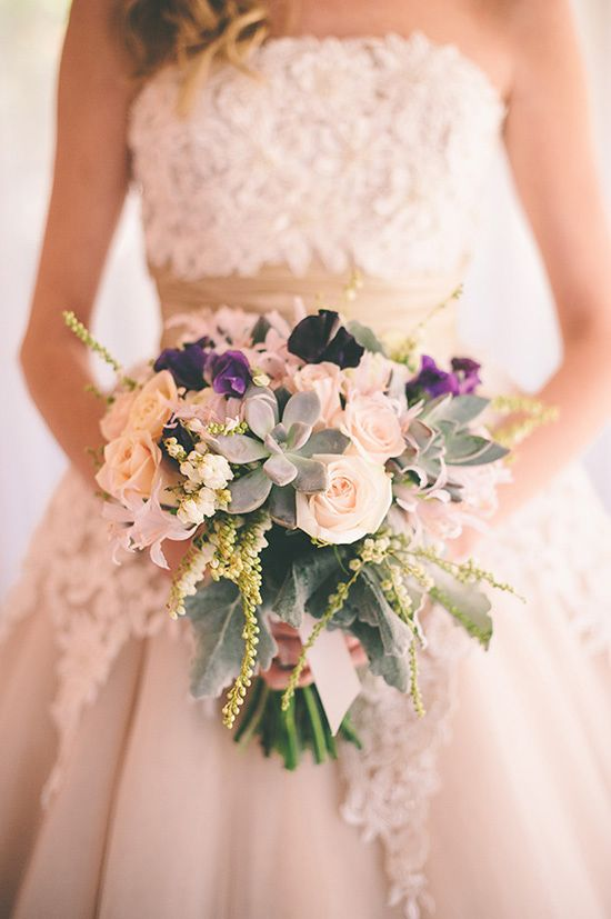 This wedding bouquet  is not really ideal but the dress the girl has on in the background is just about perfect! If it had a sweet heart neckline i'd sign on the dotted line! ;)