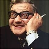 "transitive verb-""Following the dispute with the domestic servants union at Buckingham Palace, the queen, a radiant figure in a white silk gown and crimson robe, swept down the main staircase and through the hall. She then dusted the cloak room and vacuumed the lounge.""    (British comedian Ronnie Barker, sketch from ""The Two Ronnies,"" 1971)"