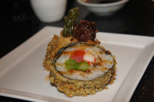 The Monkey Roll: tuna, crab, eel and asparagus inside. The entire roll was fried in a walnut, tempura mix and drizzled with eel sauce. It was plated over sriracha and spicy mayo
