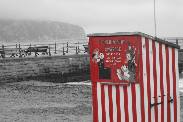 Punch and Judy on a raining Swanage beach, Dorset