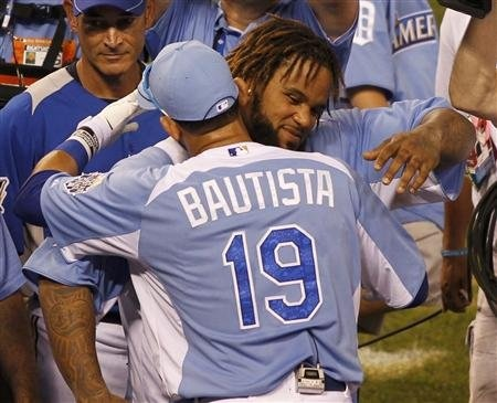 American League All-Star Prince Fielder of the Detroit Tigers is congratulated by Jose Bautista of the Toronto Blue Jays after winning the Major League Baseball All-Star Game Home Run Derby in Kansas City, Missouri, July 9, 2012.