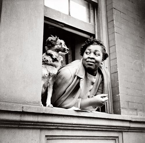 a woman and her dog in Harlem, 1943.
