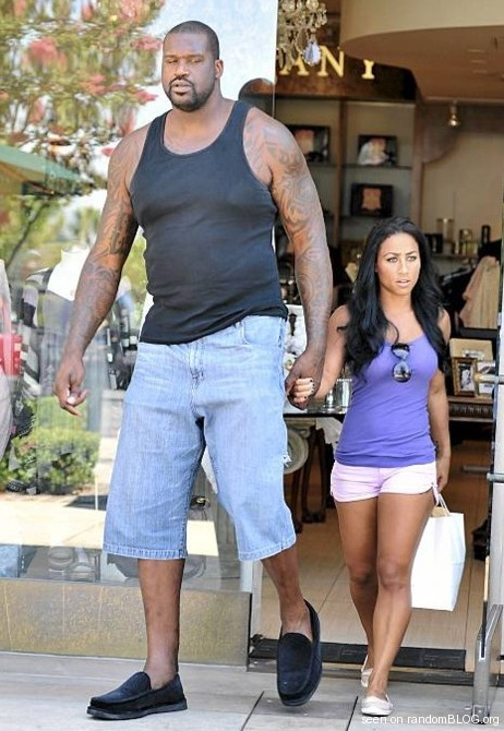 Shaq next to his Human Sized Girlfriend- I used to think Rich and I looked awkward together.. Not so much anymore. Lol