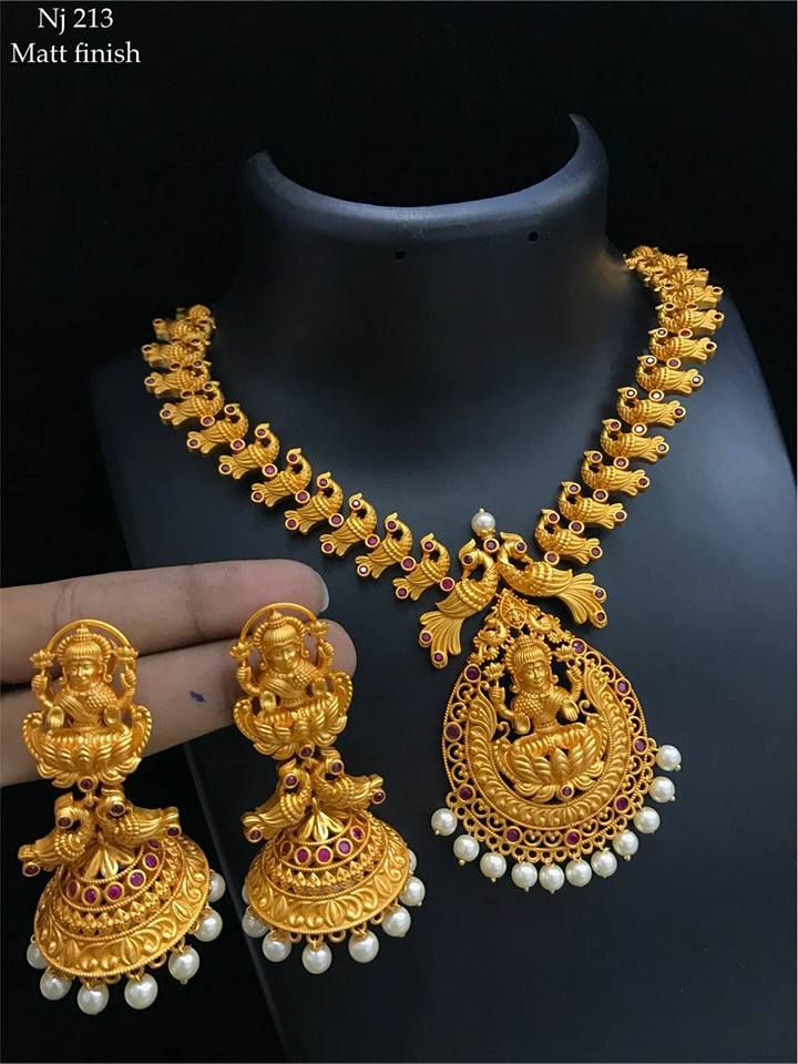 d1d21aa89 Beautiful necklace with lakshmi devi pendnat. Necklace with dancing peacock  design. Necklace studded with pink color stones. 06 January 2018