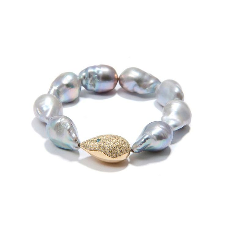 The baroque pearl bracelet from Jordan Alexander jewelry contrasts silver freshwater baroque pearls with a single gold and diamond teardrop, and unexpected aquamarine.