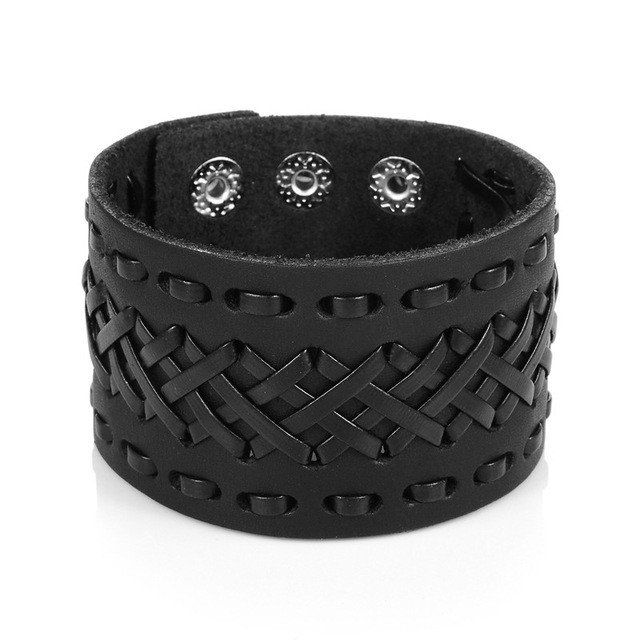 Braided Leather Wide Cuff Bracelet  This wide leather bracelet is designed with a stunning braided top and comes in black color. The bracelet is made from high quality, durable braided cowhide leather, and is adjustable to three different sizes and is suitable for both men and women.  Being one of our most popular items, this stylish handmade leather bracelet has a light, comfortable feel. This wide leather bracelet is custom made to fit your wrist size comfortably. Add it to any outfit for…