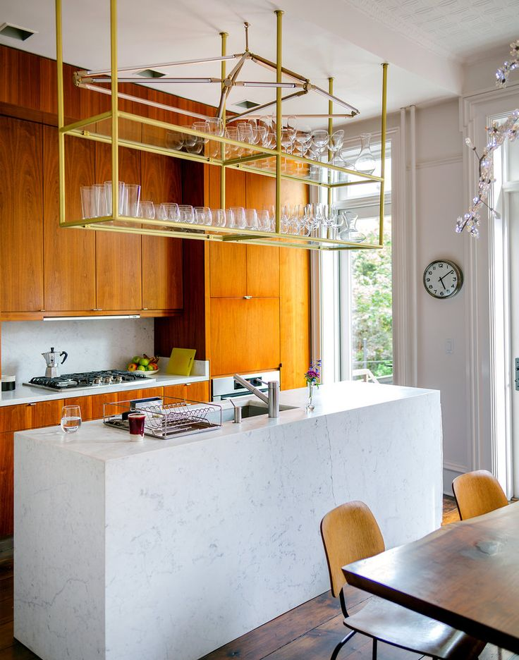 The shelf lowers down from the ceiling to deliver glasses -- beautiful and functional. #inspiredkitchen