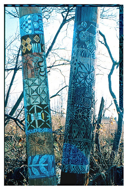 Central Maine Power utility poles in Whitefield, Maine painted with West African patterns