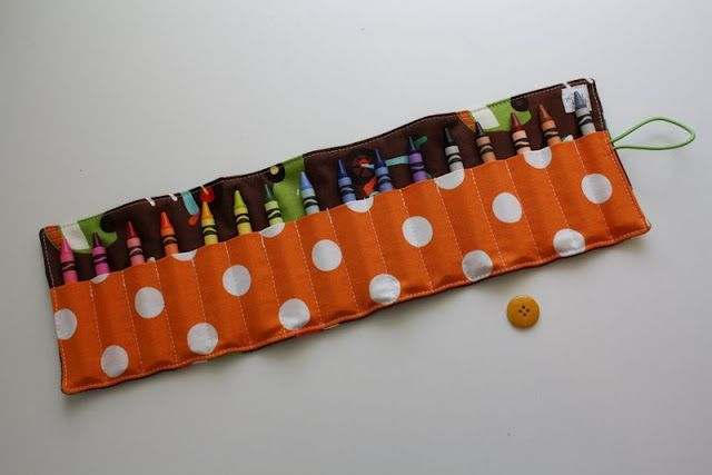 How to make a crayon roll-up by lindsey of pleated poppy. I have made many of these and they are always a big hit with kids and parents alike!