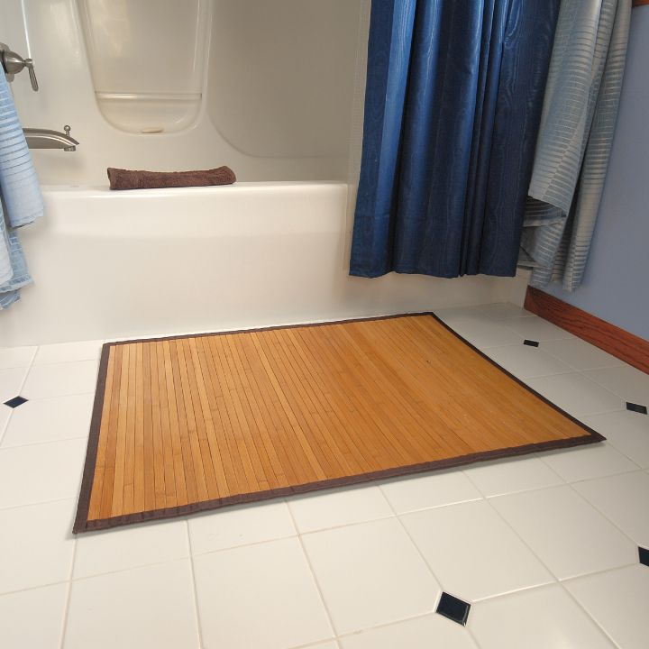 Try using a bamboo rug in the bathroom, so easy to clean.