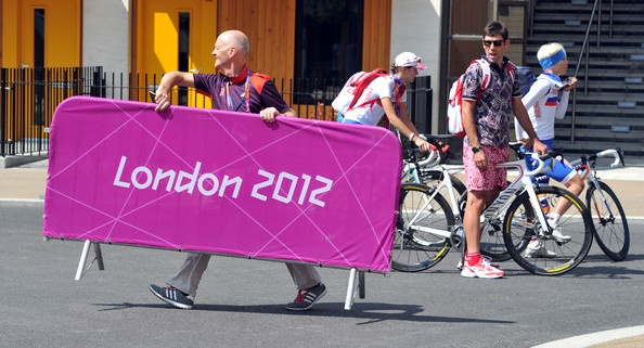 Russian Athletes on cycles ask for directions around the Athletes Village, at the London 2012 Olympic games