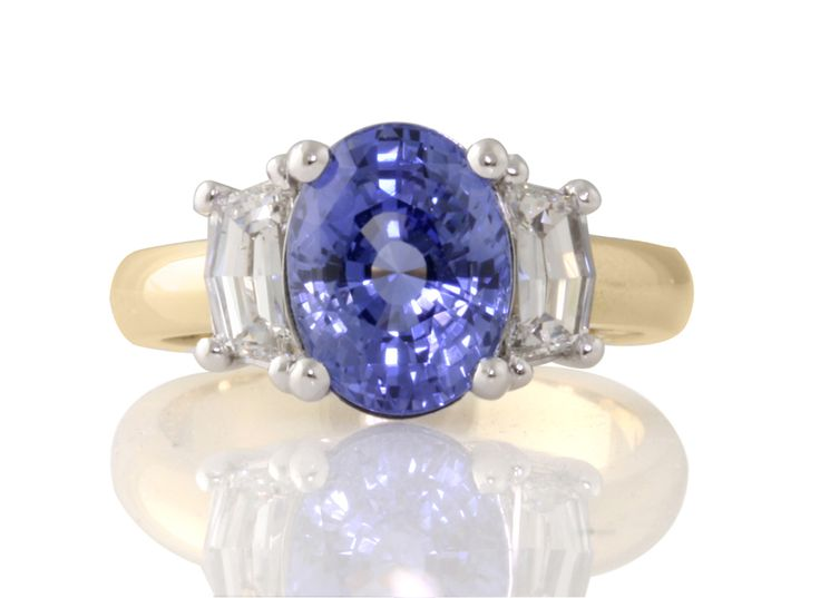 Oval Ceylon Sapphire with cadi diamonds in 18ct white and yellow gold
