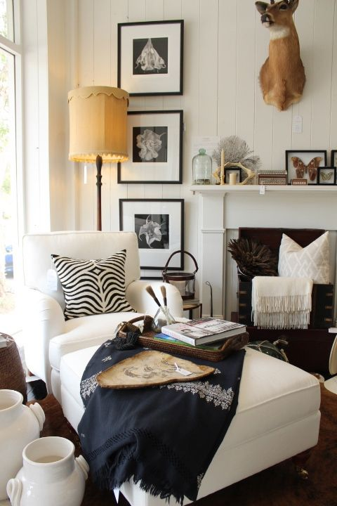 Design Tip: Beautify a narrow space with a vertical wall grouping in classic B&W. Add in a chaise and cozy throw, you're ready for a sweet retreat!