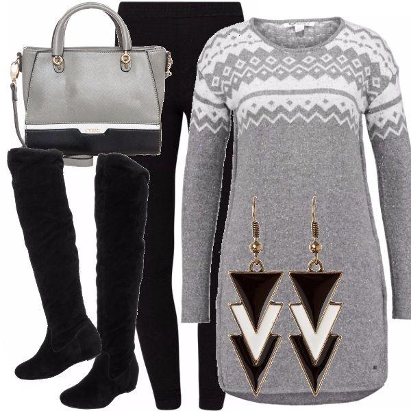Vestito a maglia con la fantasia tipica dei caldi maglioni invernali, che viene ripresa nel leggins. Stivale alto che avvolge la gamba. Orecchini pendenti che richiamano i colori dell'outfit e il motivo geometrico. Borsa a mano, in perfetto abbinamento grazie alla forma squadrata e al mix di colori.
