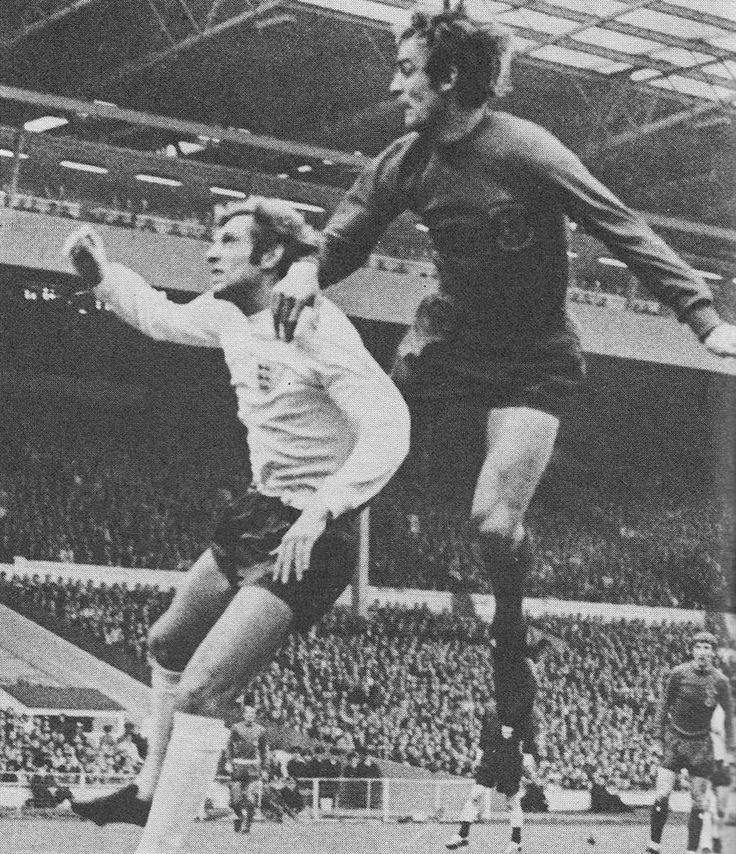 7th May 1969. Centre forward Ron Davies makes a flying leap over England full back Keith Newton to give Wales a shock opening goal, at Wembley.