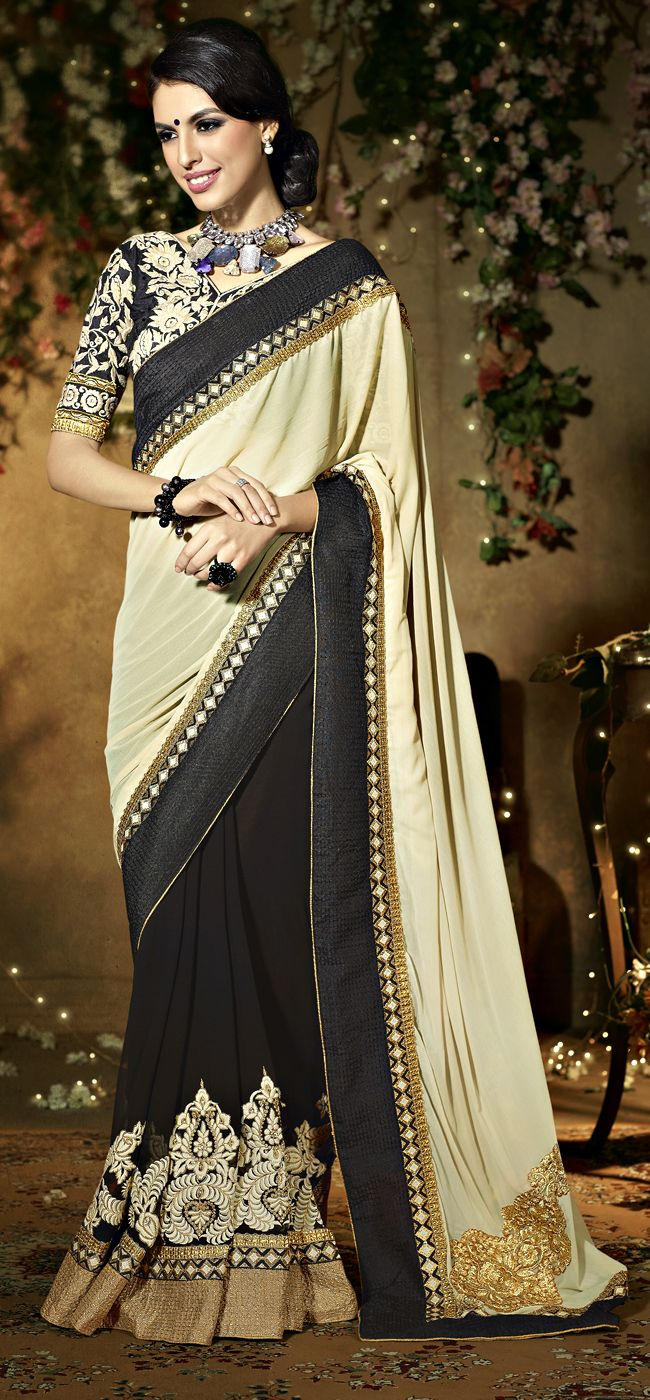 Alluring Georgette Half And Half Saree Item Code: SASW7207 PRICE:- 4856/- INR Style: Half N Half Saree occasion: Party, Festival, Reception fabric: Faux Georgette color: Black, Cream Catalog No.: 1151 work: Embroidered, Resham SHOP THIS SAREE FORM HERE http://www.vivaahsurat.com/sarees/alluring-georgette-half-and-half-saree-sasw7207