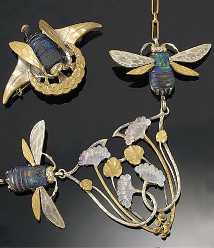 Even Empress Laisa wore glorious bug jewels; an anniversary present from Emperor Gregor (French Art Nouveau base metal & glass necklace & brooch, the necklace with a central panel of entwined elder-flowers with blue glass flowerheads, the shoulders modelled as a pair of flying insects with iridescent glass bodies, to a neckchain; and a matching flying insect brooch with iridescent glass body; each piece marked Depose)