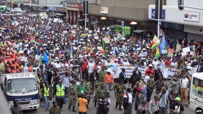 """Thousands of people take part in the """"peace march"""" against xenophobia in Durban, South Africa, on 16 April 2015"""