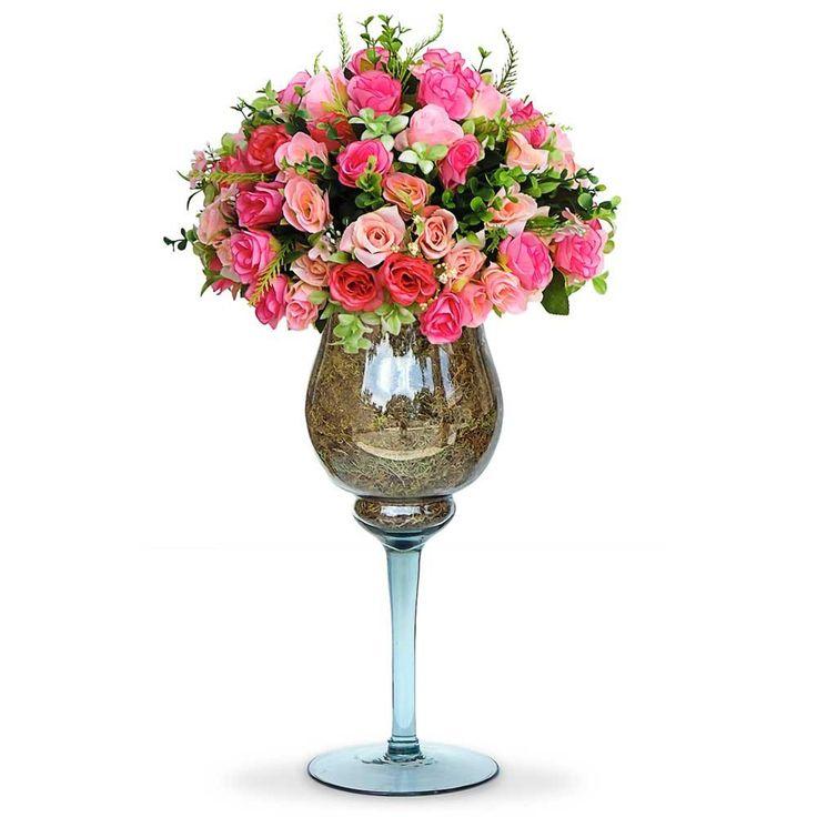 Arranjos de flores artificiais  mistas na taça de vidro, flores em seda importada com corte a laser. É uma composição Sofisticada e romântica. Vamos decorar a casa,escritório e etc, com este lindo acessório decorativo ? O Arranjo artificial de flores mistas na taça de vidro  pode ser levado a mesa sem interferir no cheiro da comida.  Excelente para os alérgicos. Incontestável em durabilidade comparada a natural. Este projeto também fica lindo em uma mesa de festa.  O valor e as dimensoes…