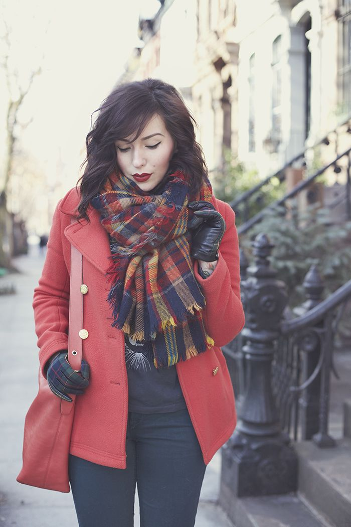 Winter outfit: Faded red trench coat, plaid scarf, jeans, matching bag.