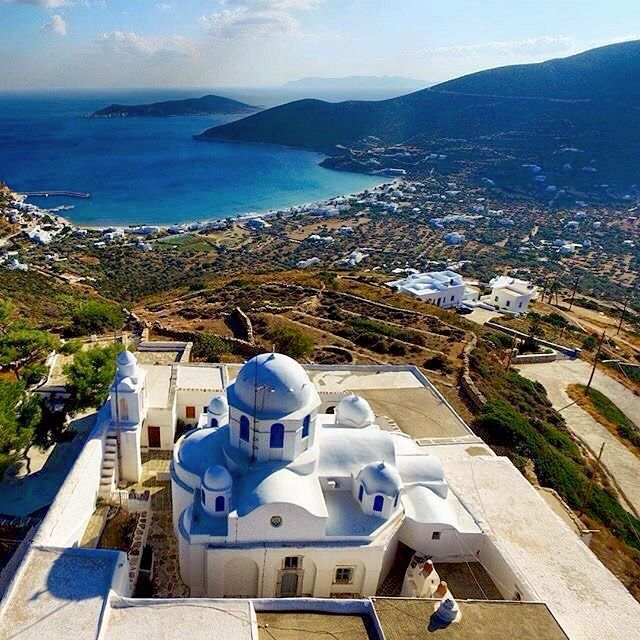 Fantastic view of Platys Gialos village over the monastery of Panagia tou Vounou (The Virgin Mary of the Mountain) , at Sifnos island (Σίφνος) . Impressive place to be if you visit the island . Very Lovely and picturesque Sifnos island .