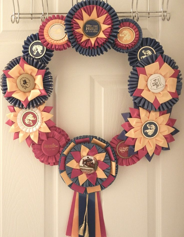Alternate to the traditional door wreath. Show Ribbon Rosette Wreath - made to order. $29.95, via Etsy.